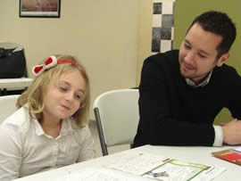 Employees from Russell Reynolds Associates tutor each month
